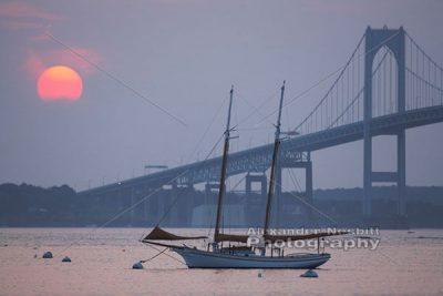 Sunset over schooner and bridge 1