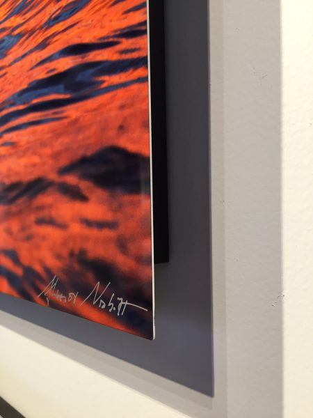 Detail of the corner of dye sublimation print showing signature and stand off from the wall