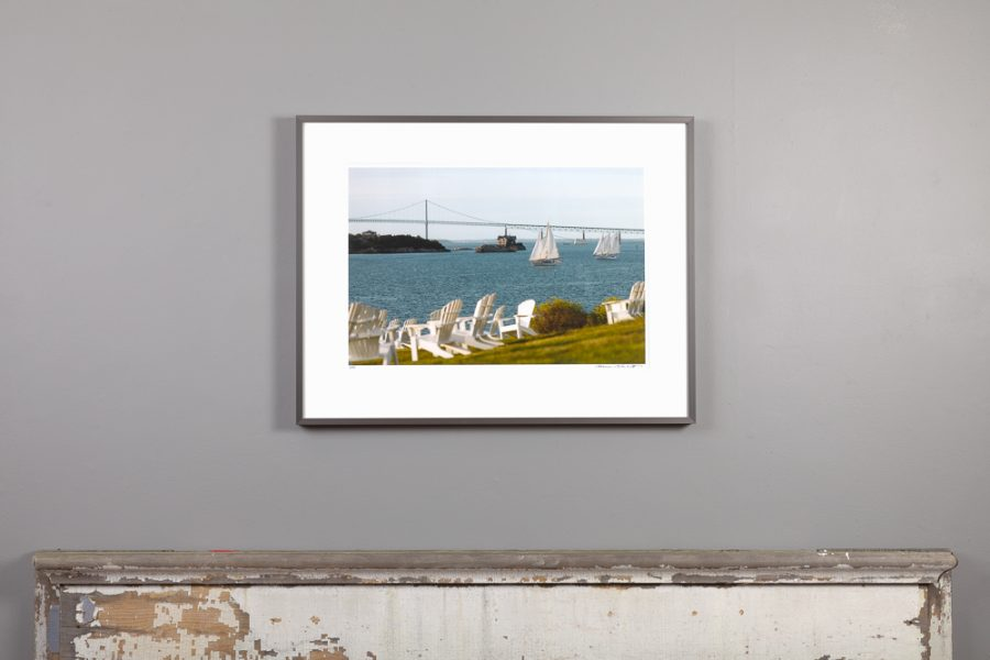 framed 13x20 image of the harbor view from Castle Hill's lawn hanging over a mantle