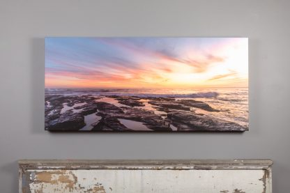 canvas print of sunset off brenton point hanging above a mantle