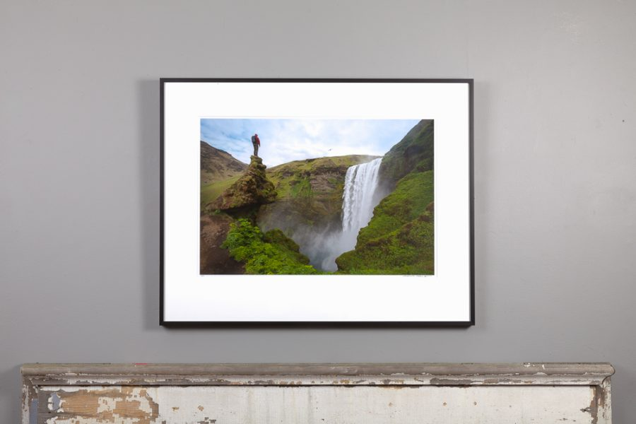 framed image featuring skogafoss in iceland hanging over a mantle