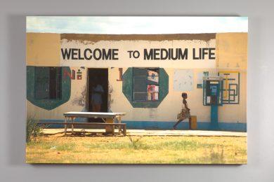 "canvas print of Nesbitt's ""welcome to medium life"" image"
