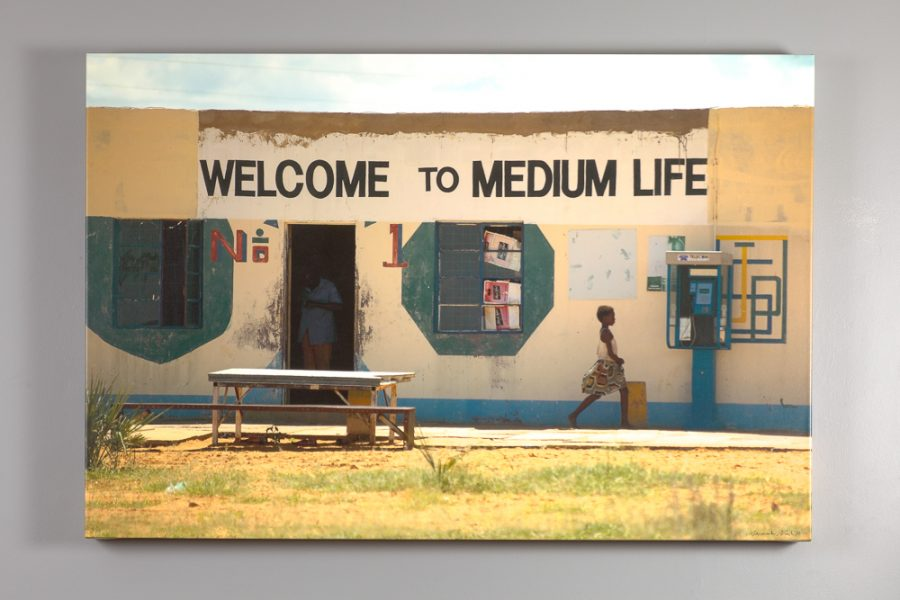 "canvas print of Nesbitt's ""welcome to medium life"" image"