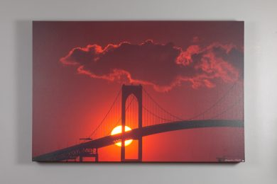 photograph of the Newport Bridge silhouetted by a blazing red sunset