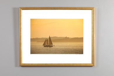 photograph of the Schooner Madeline in golden light, by Alexander Nesbitt