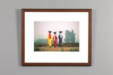 "framed image of Nesbitt's ""Village Girls"""