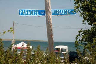 Fine art photography of the famous Paradise and Purgatory street signs at Sachuest beach, Middletown, RI.