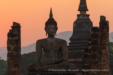 Silhouetted Buddha statues at Sukothai