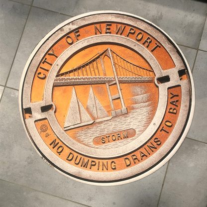 Newport Manhole cover doormat on tile floor