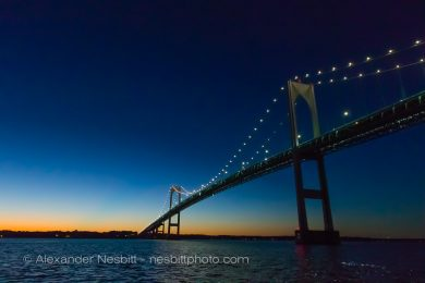 The Newport Pell Bridge seen from low on the water at dusk